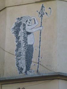 Großaufnahme: PasteUp: Kleiner Indianer mit großer Federpracht an der Mauer von Montpellier