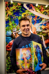 David LaChapelle with his two final books. | Copyright: Photo: Thorsten Wulff
